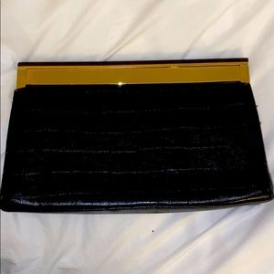 Black clutch with gold accent